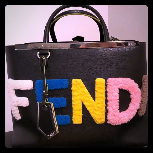 d0e99f7bdaa9 Fendi Handbags - FENDI 2Jours Shearling Logo Fur Tote Bag